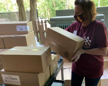 Woman lifting a cardboard box.